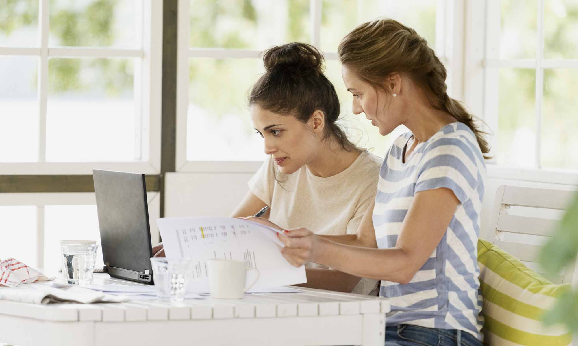 Two women in front of a laptop